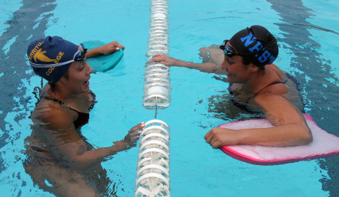 Record setting swimmers have deep bond