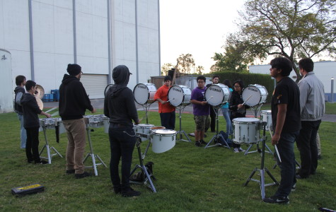 Drum line plays for school spirit
