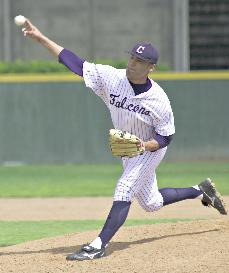 Brett Clayton of Cerritos is safe on an attempted pickoff.