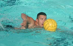 DRIVING THE BALL - Ralph Puga of the Cerritos College men´s water polo team advances the ball during practice. Puga is a member of the Army Reserves.  Photo by Elizabeth Parra/TM
