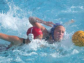 SCRAMBLE FOR THE BALL - Bethany Emmons (right) of the Cerritos College women´s water polo team races the Long Beach City College goaltender for possession of the ball.  The Vikings recorded an 18-1 win over the Falcons.