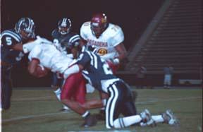 Pasadena's Smith runs over Falcons