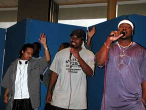 Will Nave (middle) and San Jay North (right) sing