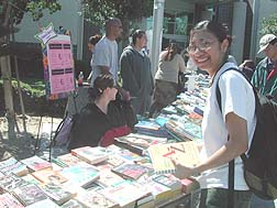 Zitlali Mays buys books from the Math Club´s book sale.