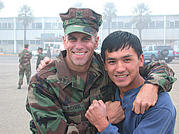 Talon Marks photographer John Ung (right) poses with buddie before reporting.