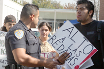 Carlos Jimenez and a campus policeman during last semesters protest that lead to their detention near the Cerritos College Elbow Room.