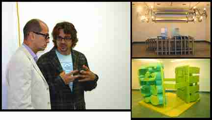 Taft Green speaks to Richard Telles, his art dealer, about his sculptures in the Cerritos College Art Gallery.