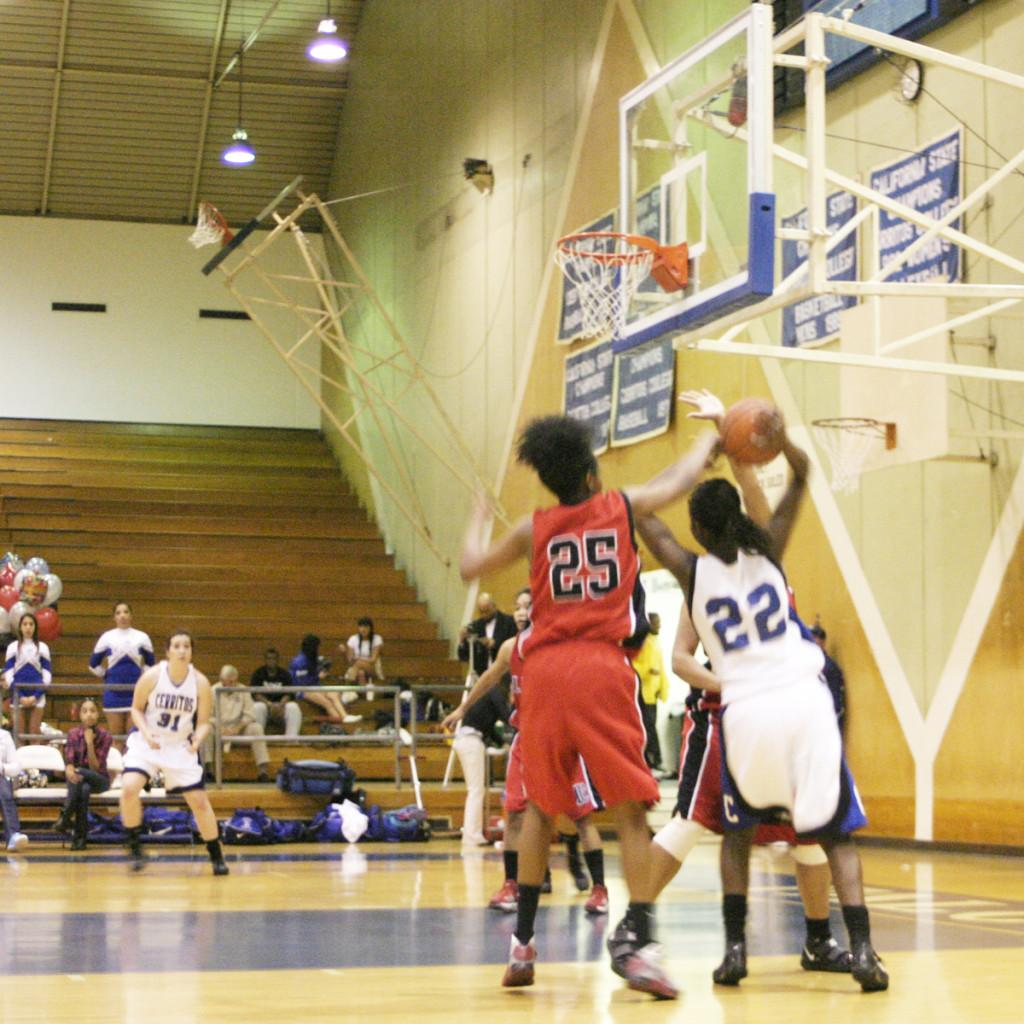 Freshman forward Rose Boatner charging into the paint during the last game of the conference to cement the Falcons as champions.