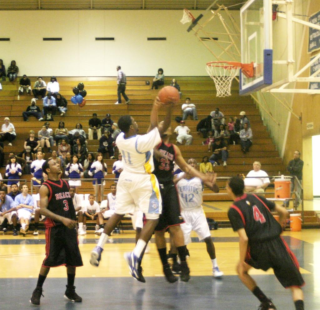 Willie Hendrix flying high and fighting for the layup in this last conference game for the Championship.