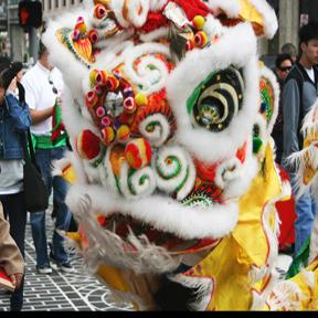 The dragon performed around Chinatown while collecting donations from stores to help the local Chinese elementary school.
