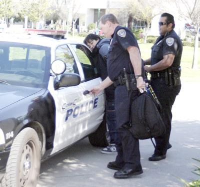 An unidentified man was taken into custody Wednesday for carrying a weapon.