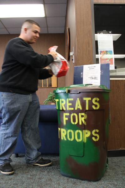 Fhilipe Grimaldo donates to the treats for troops campaign