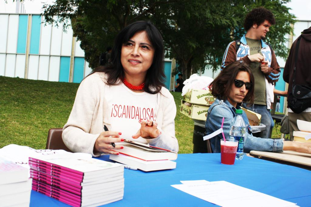 Michelle Serros signs copies of her book at the Strawberry Bonanza