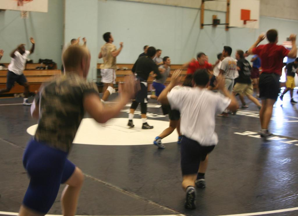 The wrestling team streching during one of its practices