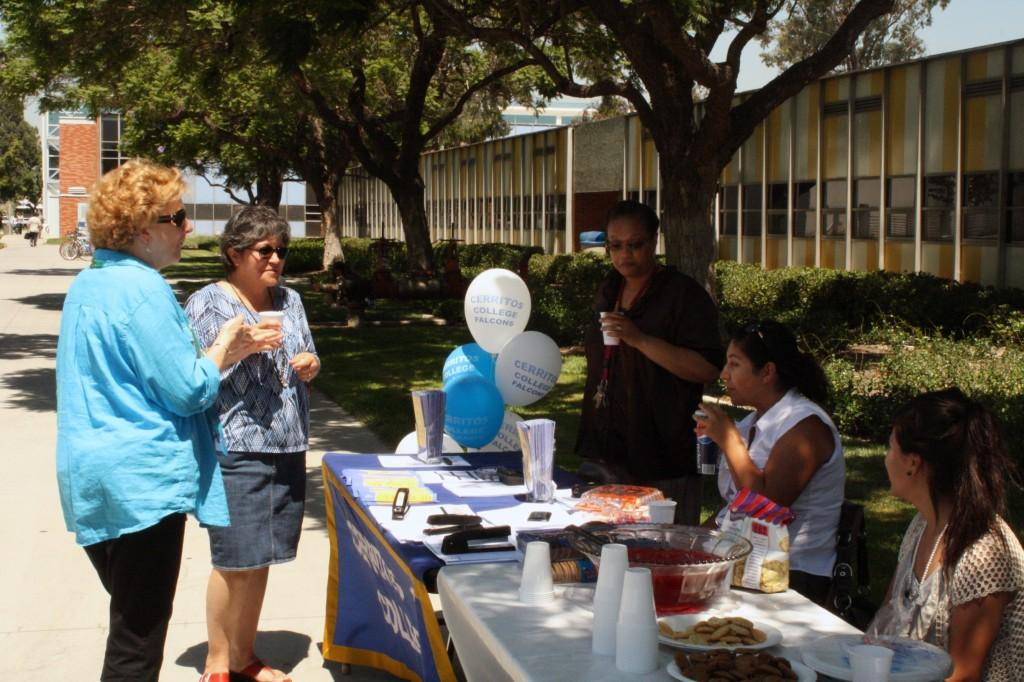 Project H.O.P.E.s workers and students assisted people who had questions at the programs open house.