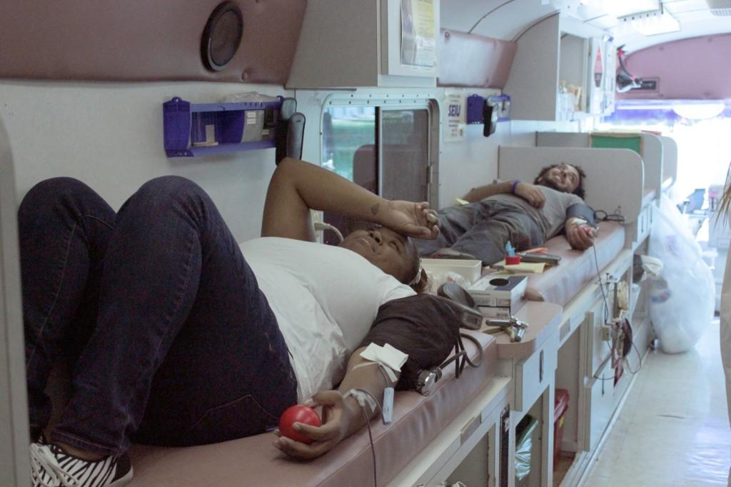 Education major Chantel Samuels and biology major Kirelos Habib wait to give their blood donations. According to Red Cross Senior Field Manager Rob Torrez, the limited amount of resources available led to students leaving the blood drive due to not having enough time.