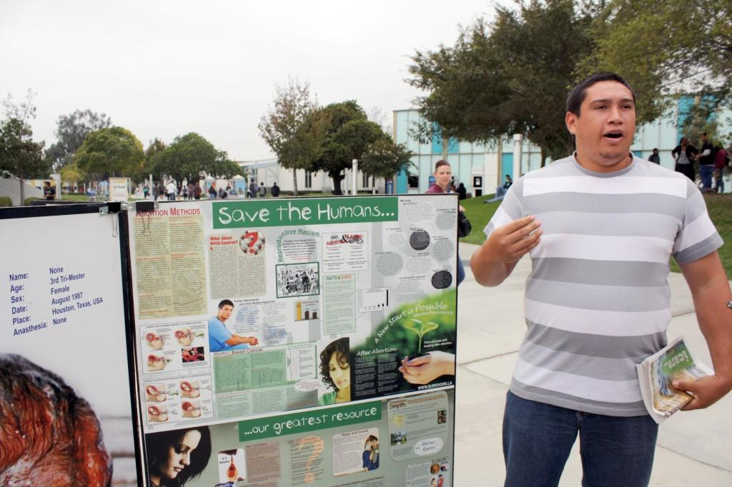 Team member Daniel Rivera spent most of the day explaining the effects of abortions at Cerritos College.