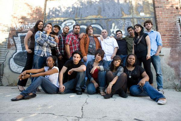 Cast of Urban Theatre Movement posing for a photo op.