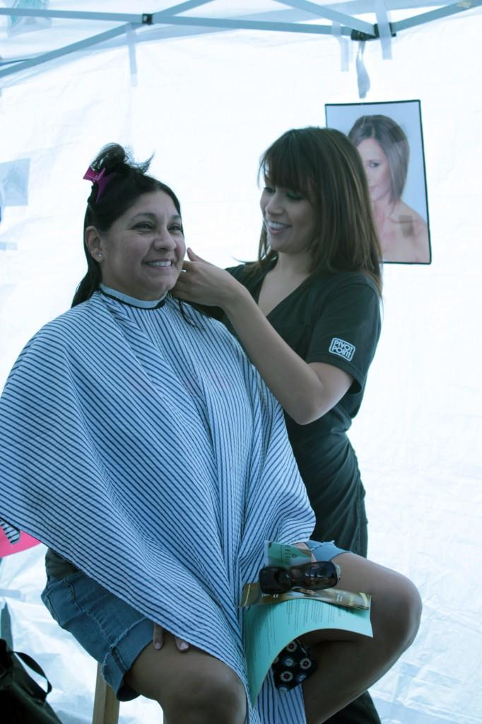 Cosmetology student Gina Ortega cuts Norwalk resident Sally Gaitan's hair. On Sept.11, the Cosmetology Department offered its services for Locks of Love.