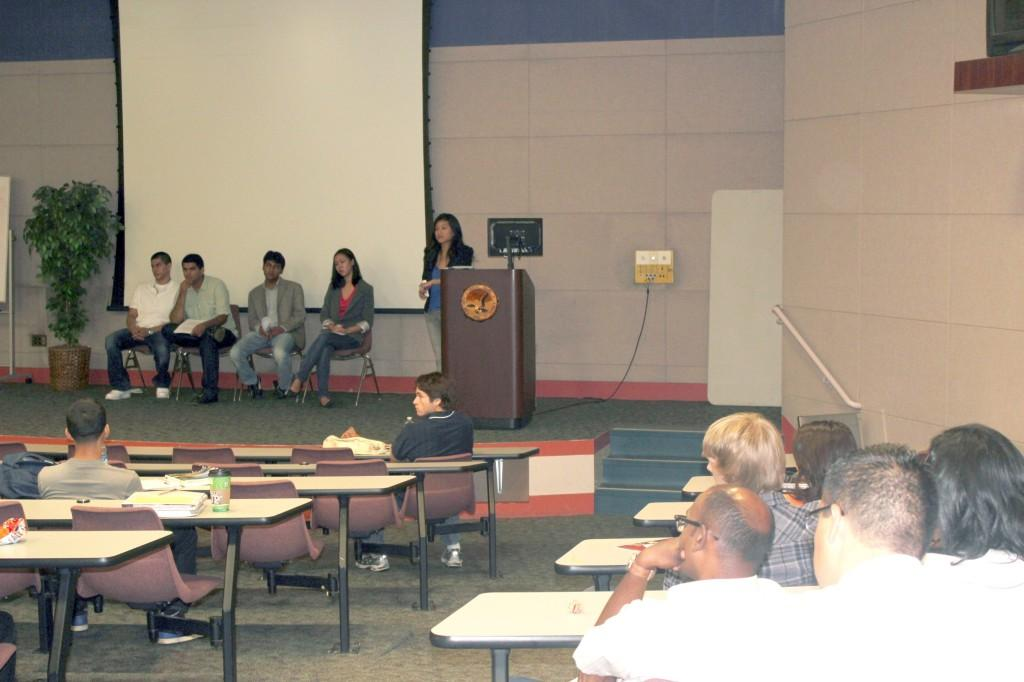 Students from the economics club present their discussion on the Nov. 2 elections. The club's members focused on Jerry Brown and Meg Whitman's plans for education.