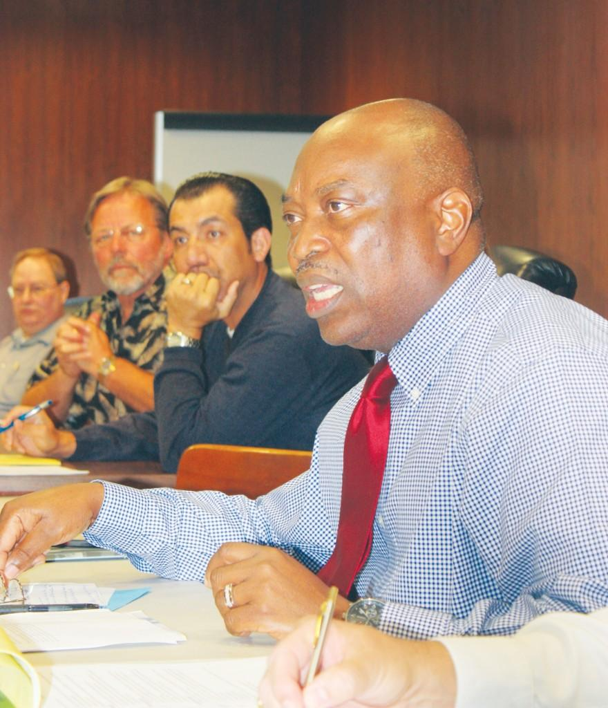 Political science professor Victor Obasohan expresses his concern for the college reorganization plan at the Oct. 26 faculty senate meeting.