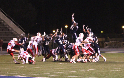 Keith McGill, No. 37, blocks the possible winning field goal. The ball was recovered and ran back