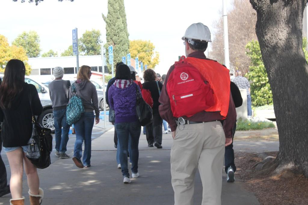 Students returning to class after a campus wide evacuation drill. Designated-area team leaders were assigned to make sure the drill was carried out effectively.