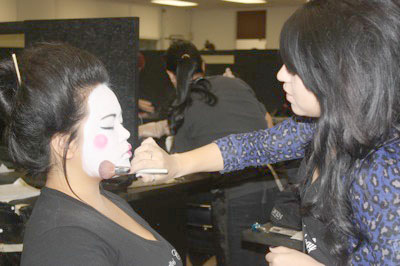 Krystal Martinez (right) is working on her client and fellow classmate, Teresa Angcaco, as she transforms Teresa from head to toe into a Geisha.