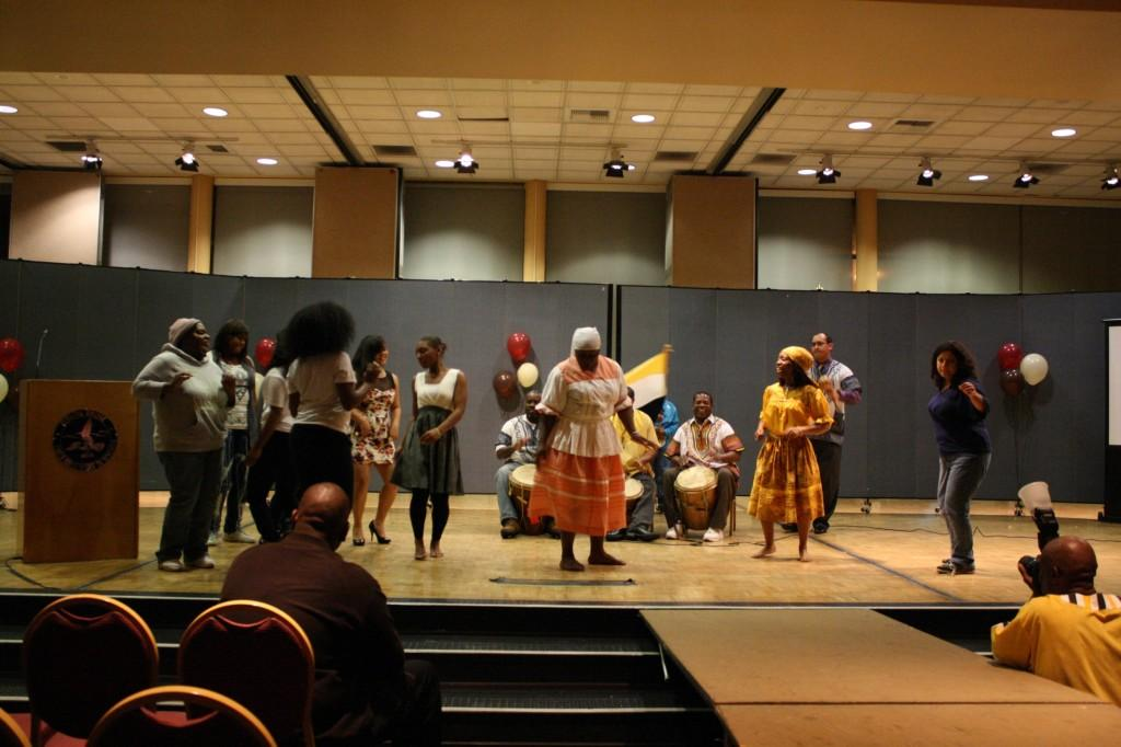 The Garifuna Heritage Cultural Group performed small dance pieces from Central America. After, the audience was encouraged to join in dance with children following along.