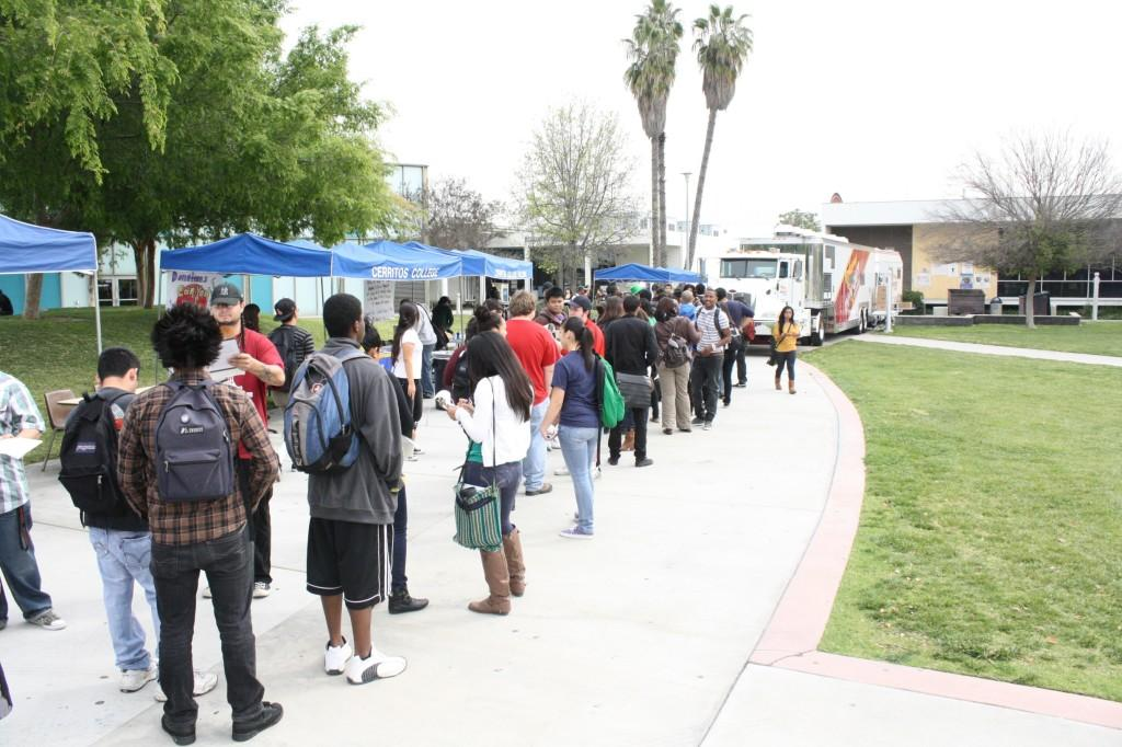 Students stand in line to get free In-N-Out. ASCC President Filpe Grimaldo asked students to sign a petition that he will send to six legislators.