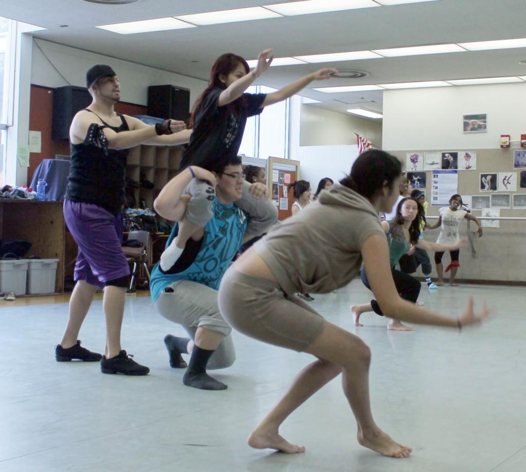 Dance majors Sandy Ramos and Richard Silva (both center) rehearse in the studio. Both will be performing in the concert.