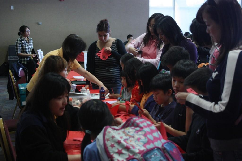 Students and community residents alike enjoy the festivities at the Spring Festival. The Spring Festival celebrates the Chinese New Year.