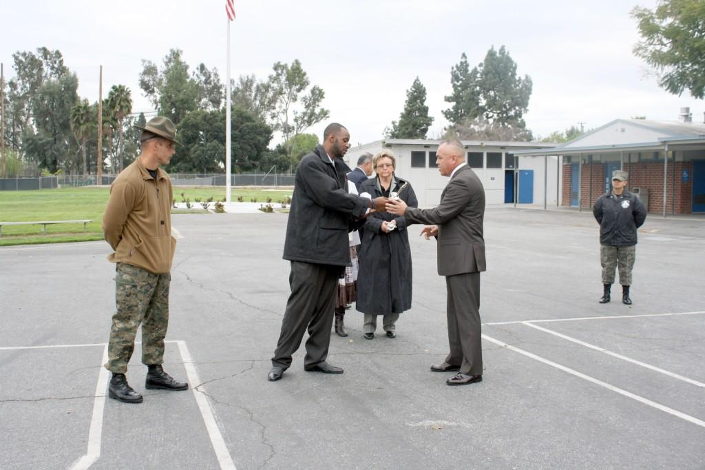 Tremel Stewart hands Master Sgt. Schafer an award for his continued support for the BSU.