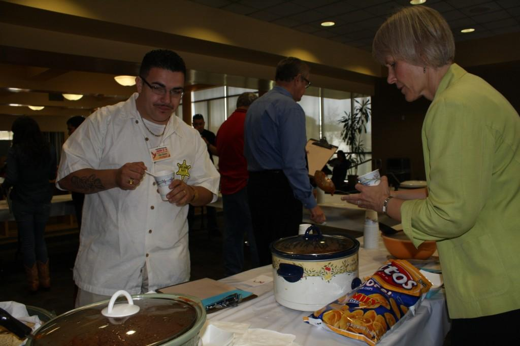 ASCC President Felipe Grimaldo and Faculty Senate Debra Moore enjoy judging the Chili Cook Off competition. Three winners were awarded one for most unique chili, one for the hottest chili and another for judge's favorite.