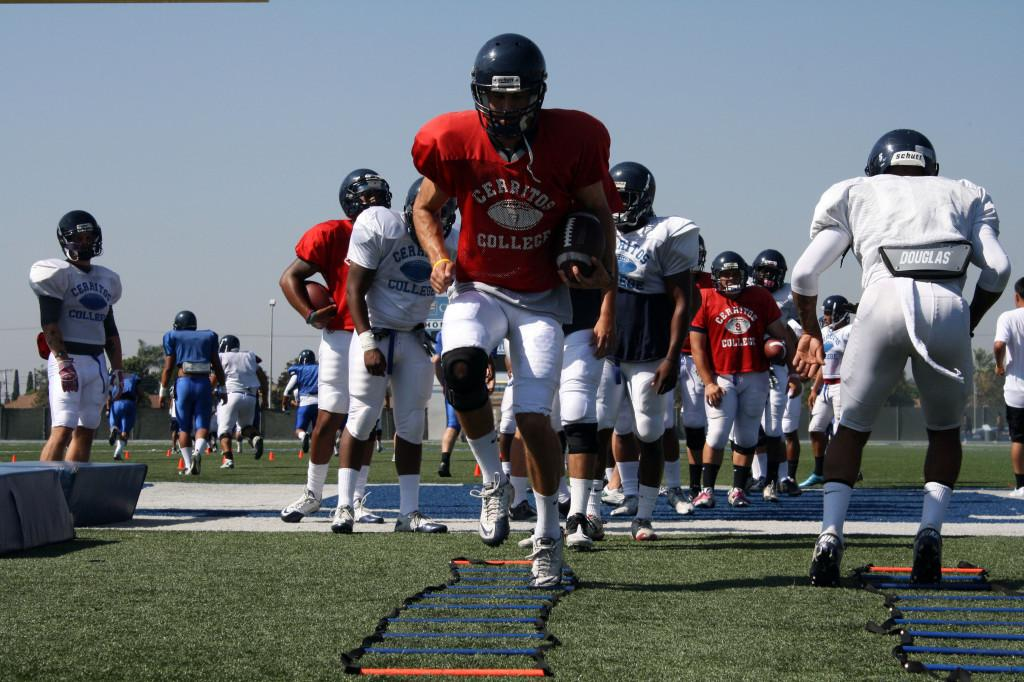 Quarterback Morgan Fennell is in the middle of the football team's ladder drills during practice. He and sophmore Brandon Denker are in a battle for the starting quarterback position.