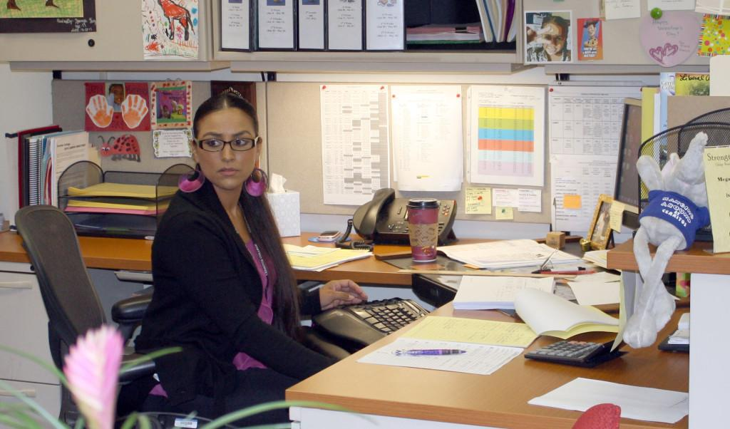 Newly-promoted Liberal Arts Divisional Secretary Megalis Lopez in her office. Lopez was recently awarded Classified Employee of the Month.