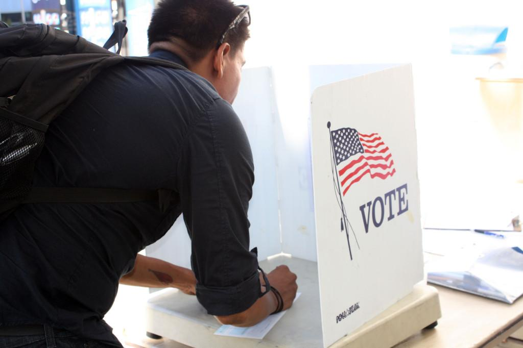 A Cerritos student casting his vote at the Social Science patio. The ASCC Senate elections took place on Sept. 7 and 8 at multiple locations around the campus.