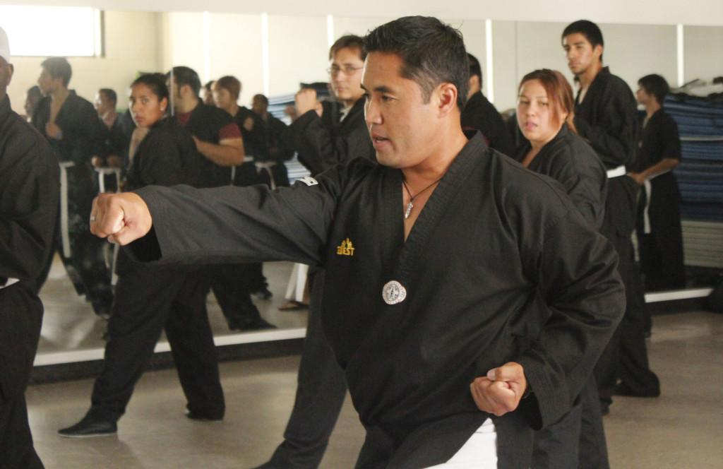 Learning from the master: Tae Kwon Do Instructor Vicmar Coliflores teaching students new Tae Kwon Do moves. Cerritos College offers Tae Kwon Do classes for the first time this semester.