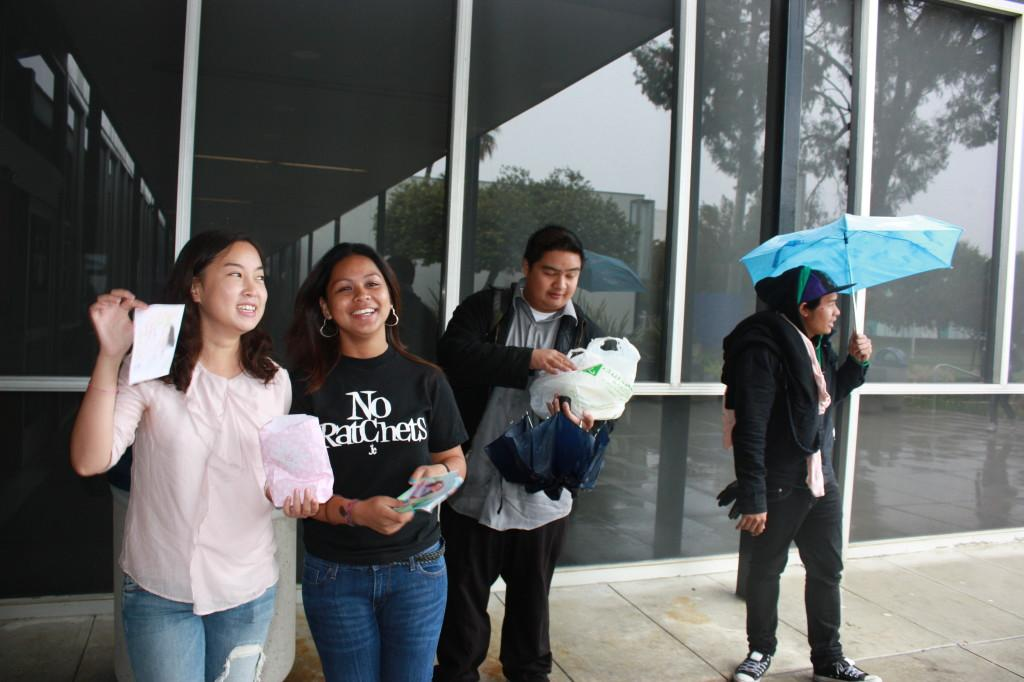 International Students Association candidate Yeim Bae (Left), with club members Abner Caguina (middle right), and Aljen Medillio (right) campaign for Bae. She is one of the women who made it to Homecoming Court.