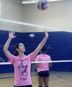 Libero Madison Guastella practices during a Falcons pre game warm up. She is also a model.
