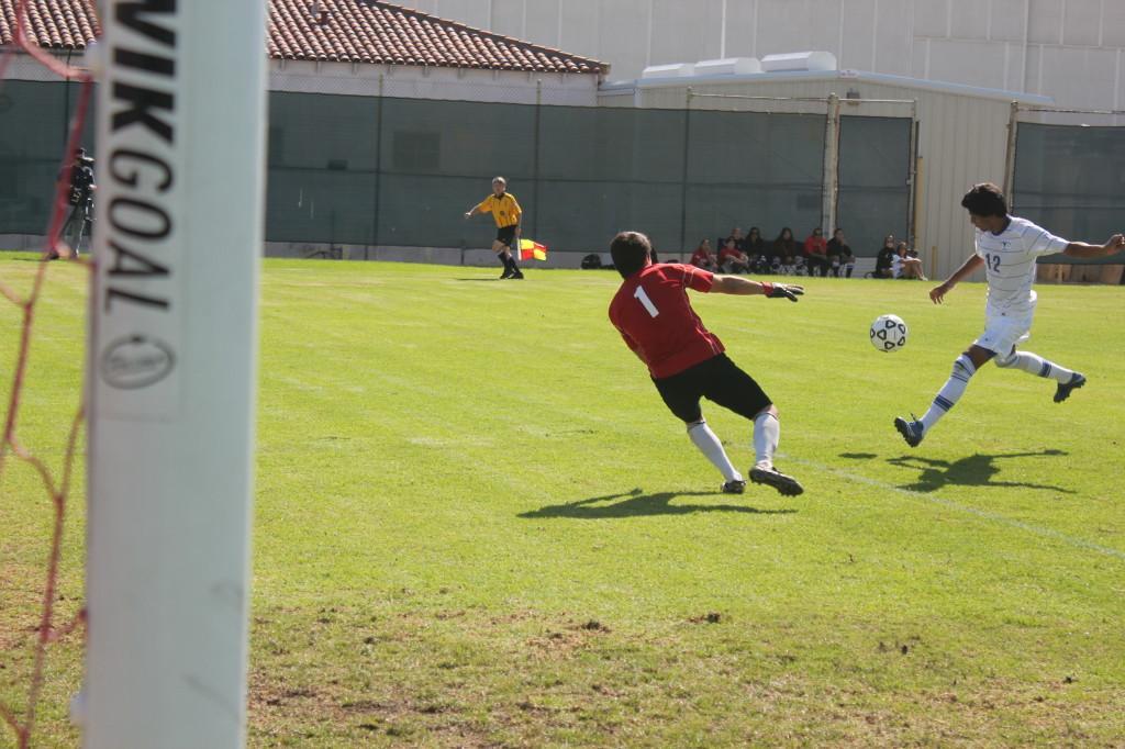 Foward Alberto Lazaro looks to shoot on Long Beach City goalkeeper Cesar Tamayo.