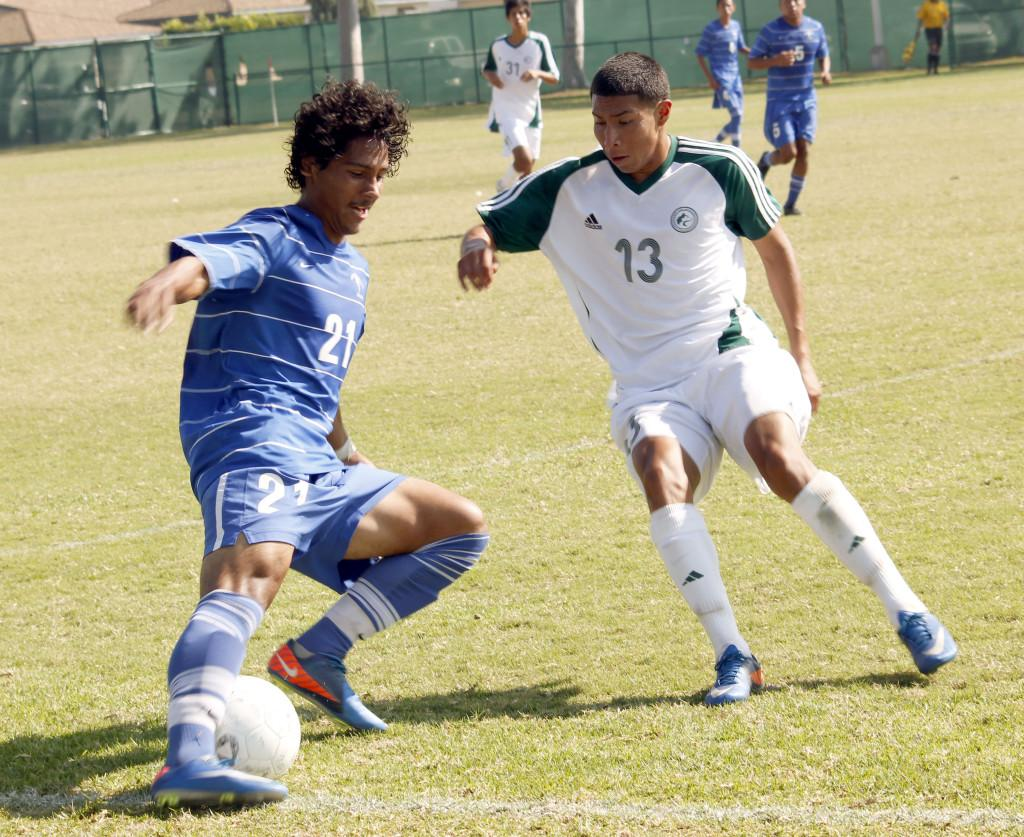 Freshman midfielder Carlos Escobar works the ball against an East Los Angeles College defender in the Falcons' 3-1 win on Tuesday. Escobar has played in 13 games this season.