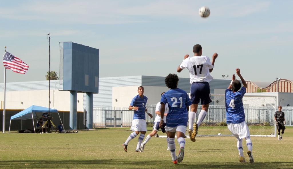 El Camino freshman Kevin Alfaro hanging in the air after launching the ball toward Cerritos' goal. Cerritos' defense held El Camino to 1 shot on its goal at the end of the first half.