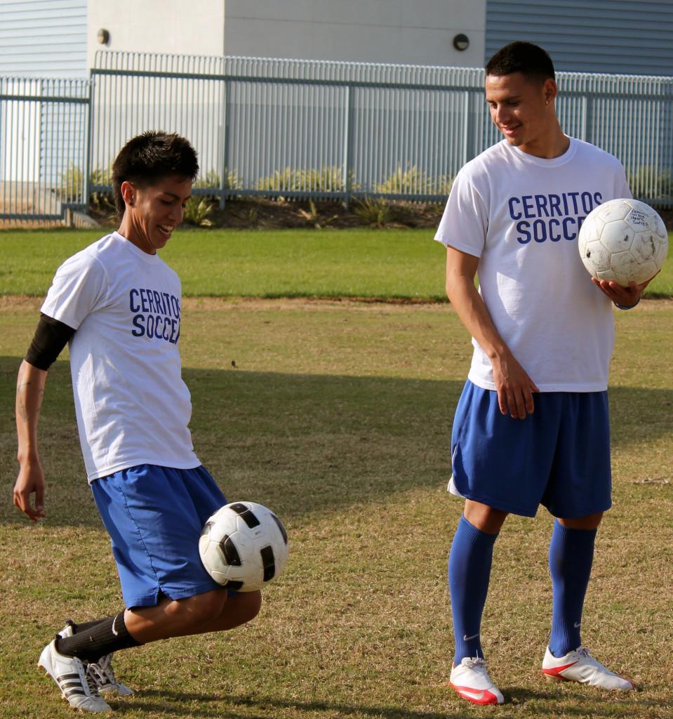 Sophomore midfielder Alex Ayala practices dribbling the ball in a drill. The Falcons have a bye during the first round of playoffs.