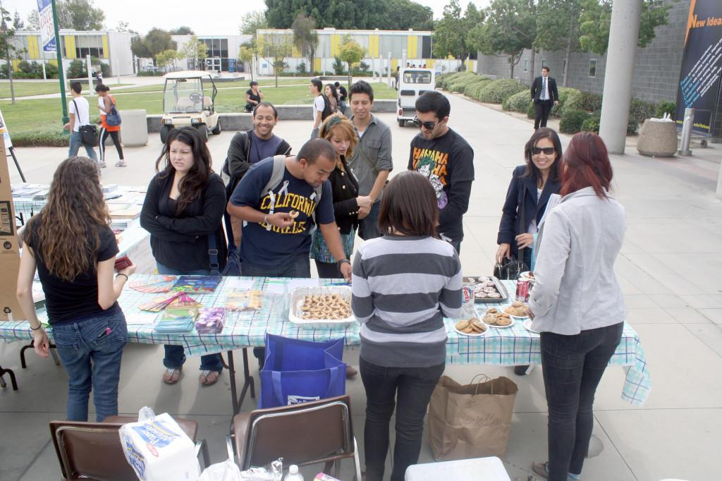Members of the Active Minds Club sell snacks to Cerritos College students during its Suicide Awareness event on Thursday. The event hosted several speakers, including Congresswoman Grace Napolitano, to provide information on how to help those suffering from mental illnesses.