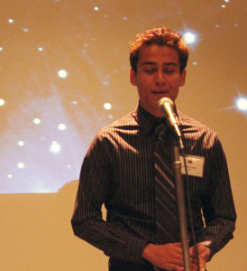 Public relations major Santiago Zuniga recites a poem at the Library Club's poetry night on Nov. 30. The event gave students the opportunity to recite their poems in a competition.