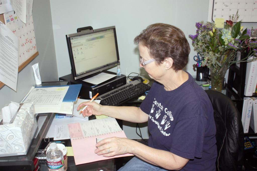 Intermediate typist clerk Nancy Mirabella during work. Mirabella recently retired from her position after nine years.