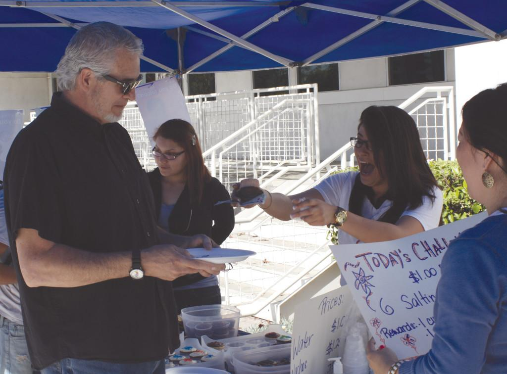 Cerritos College Multimedia Product Specialist Michael Wisniewski purchased a cookie from the iFalcon Club. The cookie costed $5 during the bakesale.