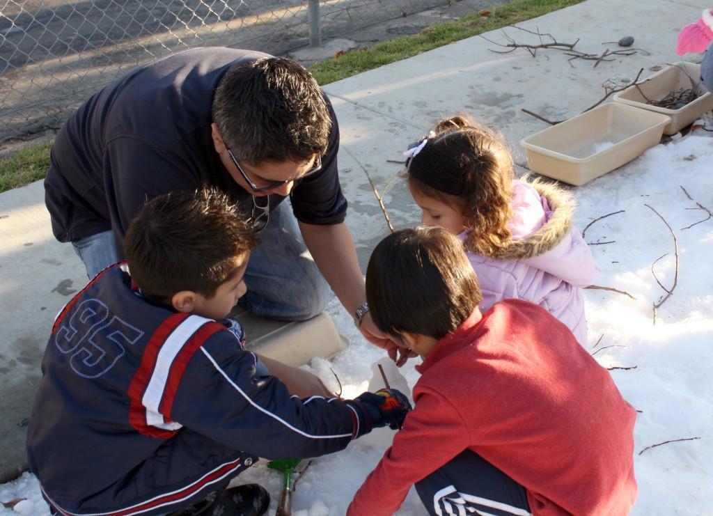Edgar Aranda his children, Elijah and Yomaris take part in the annual Cerritos College snow day.