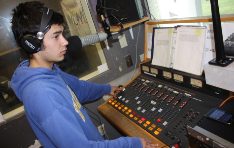 "Radio host for ""The Nonsense Hour,"" Angel Alcala, working on the control board in the WPMD station on campus. Alcala started his show last semester to play music."